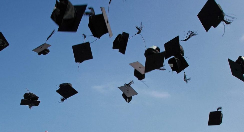 Graduation caps mid-air